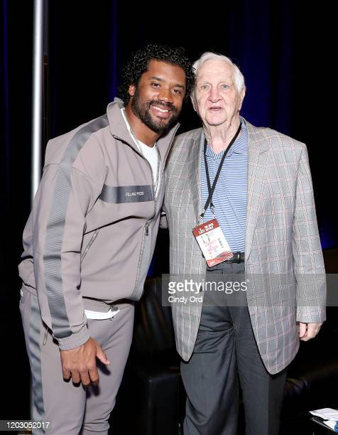 NFL quarterback Russell Wilson of the Seattle Seahawks and SiriusXM host Gil Brandt attend day 2 of SiriusXM at Super Bowl LIV on January 30 2020 in...