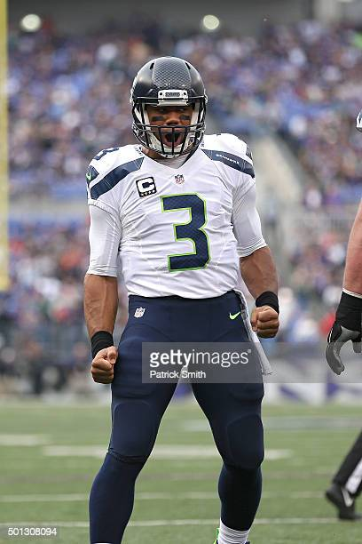 Quarterback Russell Wilson of the Seattle Seahawks celebrates a teammates touchdown against the Baltimore Ravens at MT Bank Stadium on December 13...