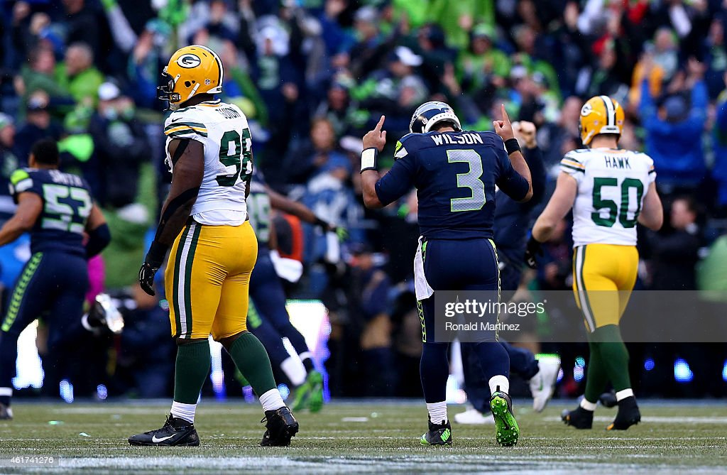 Quarterback Russell Wilson #3 of the Seattle Seahawks celebrates after throwing the game winning touchdown pass to Jermaine Kearse #15 in overtime to defeat the Green Bay Packers 28-22 during the 2015 NFC Championship game at CenturyLink Field on January 18, 2015 in Seattle, Washington.