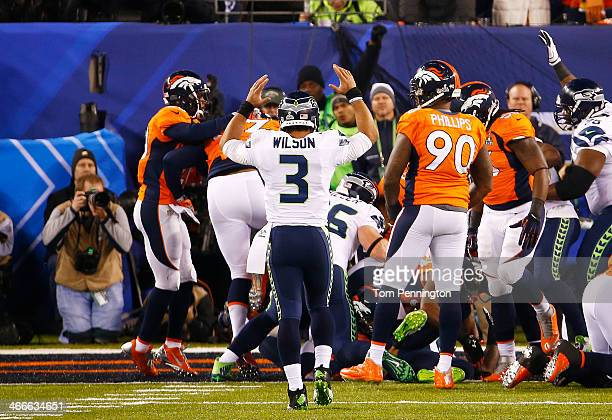 Quarterback Russell Wilson of the Seattle Seahawks celebrates aftering running back Marshawn Lynch scored a one yard touchdown during the second...