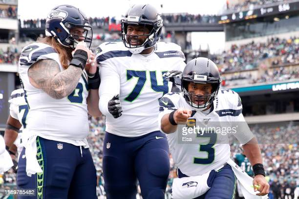 Quarterback Russell Wilson of the Seattle Seahawks celebrates in the end zone after throwing a first quarter touchdown pass against the Philadelphia...