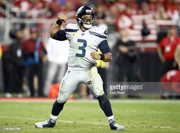 Quarterback Russell Wilson of the Seattle Seahawks celebrates the touchdown by running back Chris Carson in the third quarter against the San...