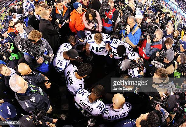 Quarterback Russell Wilson of the Seattle Seahawks celebrates with teammates on the field after Super Bowl XLVIII at MetLife Stadium on February 2...