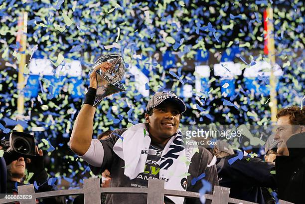 Quarterback Russell Wilson of the Seattle Seahawks celebrates with the Vince Lombardi Trophy after their 438 victory over the Denver Broncos during...