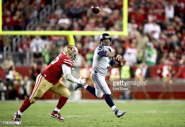Quarterback Russell Wilson of the Seattle Seahawks delivers a pass against the defense of the San Francisco 49ers at Levi's Stadium on November 11...