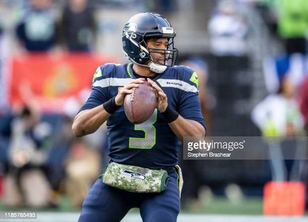 Quarterback Russell Wilson of the Seattle Seahawks drops back to pass during a game against the Tampa Bay Buccaneers at CenturyLink Field on November...