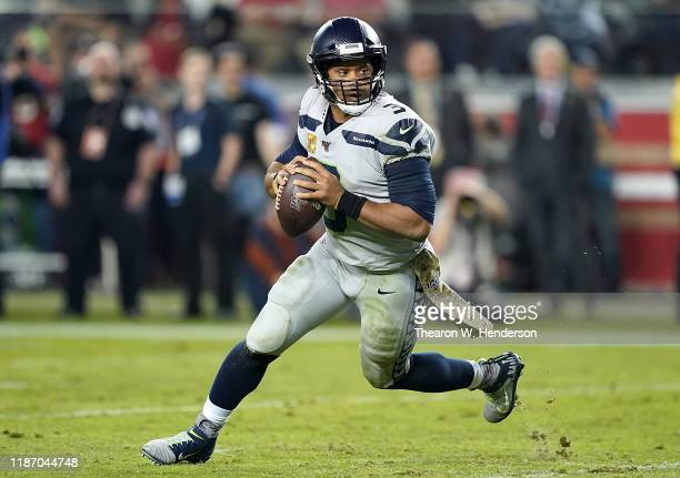 Quarterback Russell Wilson of the Seattle Seahawks drops back to pass against the defense of the San Francisco 49ers in the game at Levi's Stadium on...