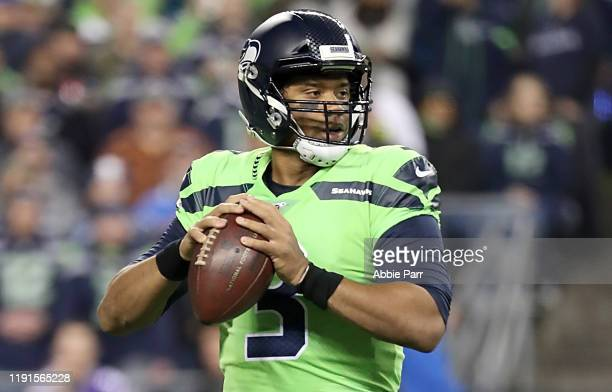 Quarterback Russell Wilson of the Seattle Seahawks drops back to pass against the Minnesota Vikings at CenturyLink Field on December 02 2019 in...