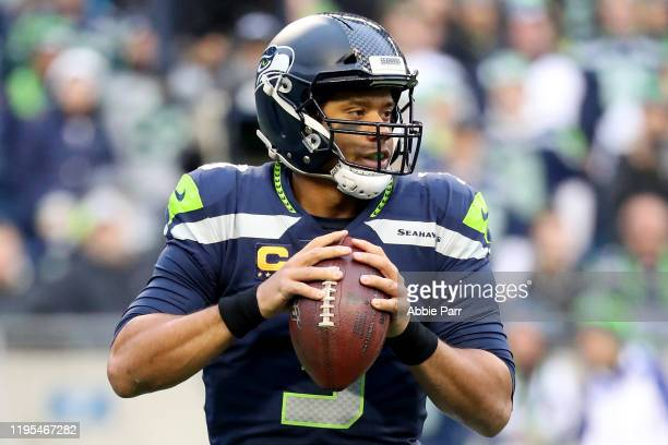 Quarterback Russell Wilson of the Seattle Seahawks drops back to pass over the defense of the Arizona Cardinals during the game at CenturyLink Field...