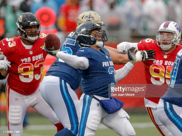 Quarterback Russell Wilson of the Seattle Seahawks from the NFC Team on a pass play while Defensive End Calais Campbell of the Jacksonville Jaguars...
