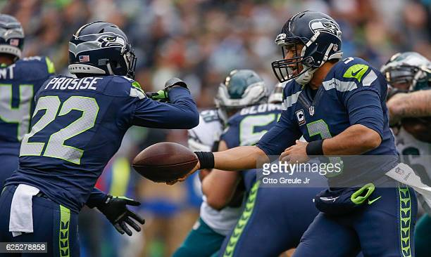 Quarterback Russell Wilson of the Seattle Seahawks hands off to running back CJ Prosise against the Philadelphia Eagles at CenturyLink Field on...