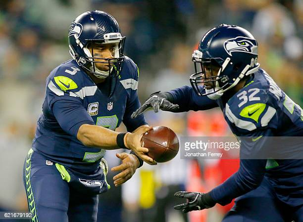 Quarterback Russell Wilson of the Seattle Seahawks hands the ball off to Running back Christine Michael against the Buffalo Bills at CenturyLink...