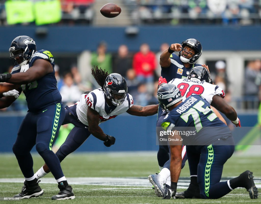 Quarterback Russell Wilson #3 of the Seattle Seahawks has his pass batted down at the line of scrimmage during the first quarter of the game at CenturyLink Field on October 29, 2017 in Seattle, Washington.