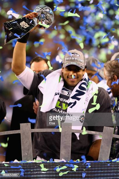Quarterback Russell Wilson of the Seattle Seahawks holds the Vince Lombardi Trophy after winning Super Bowl XLVIII at MetLife Stadium on February 2...