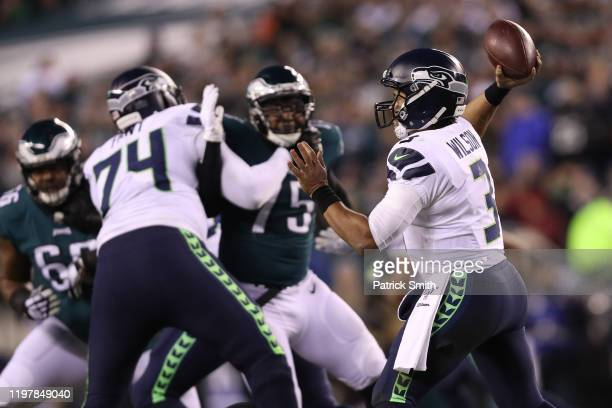 Quarterback Russell Wilson of the Seattle Seahawks in action against the Philadelphia Eagles during their NFC Wild Card Playoff game at Lincoln...