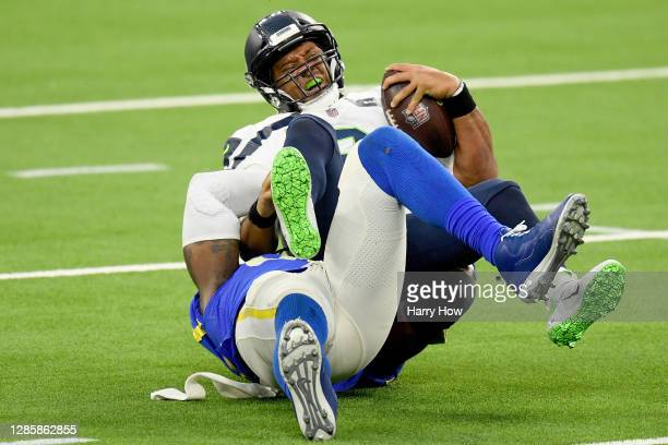 Quarterback Russell Wilson of the Seattle Seahawks is sacked by Michael Brockers of the Los Angeles Rams in the fourth quarter at SoFi Stadium on...