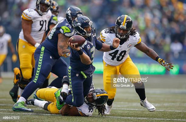 Quarterback Russell Wilson of the Seattle Seahawks is sacked by linebacker Jarvis Jones of the Pittsburgh Steelers in the second quarter at...