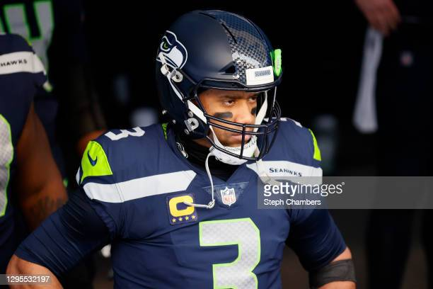 Quarterback Russell Wilson of the Seattle Seahawks leads his team onto the field to start the NFC Wild Card Playoff game against the Los Angeles Rams...