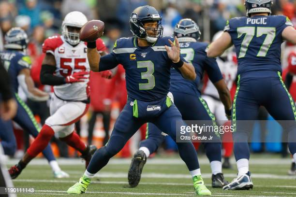 Quarterback Russell Wilson of the Seattle Seahawks passes against the Arizona Cardinals at CenturyLink Field on December 22 2019 in Seattle Washington