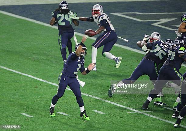 Quarterback Russell Wilson of the Seattle Seahawks passes against the New England Patriots in the Super Bowl at University of Phoenix Stadium on...