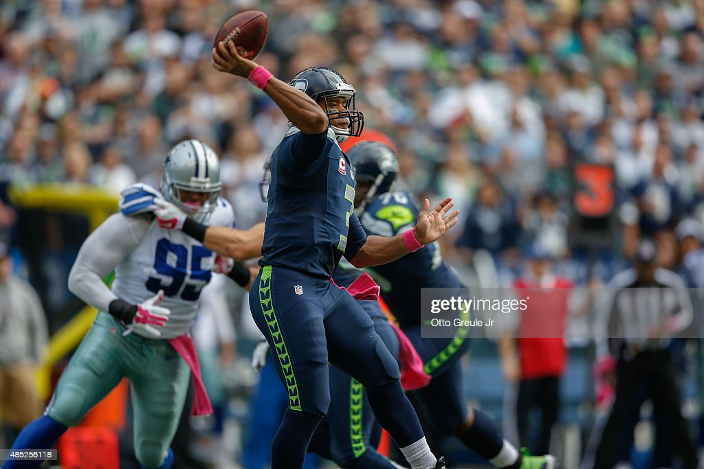 Quarterback Russell Wilson #3 of the Seattle Seahawks passes against the Dallas Cowboys at CenturyLink Field on October 12, 2014 in Seattle, Washington.