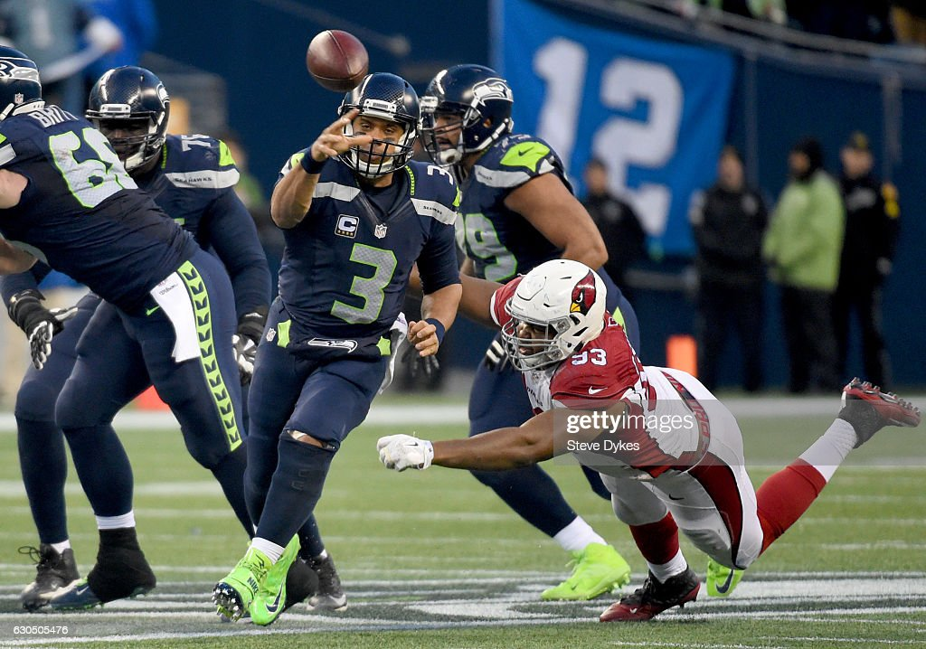 Quarterback Russell Wilson #3 of the Seattle Seahawks passes against the Arizona Cardinals at CenturyLink Field on December 24, 2016 in Seattle, Washington.