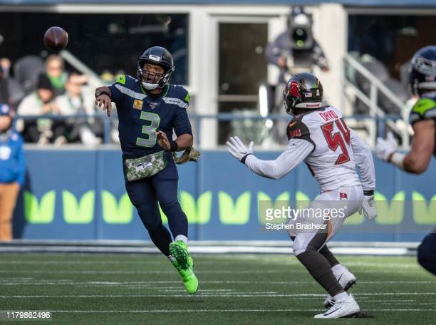 Quarterback Russell Wilson of the Seattle Seahawks passes the ball as linebacker Lavonte David of the Tampa Bay Buccaneers defends during the first...