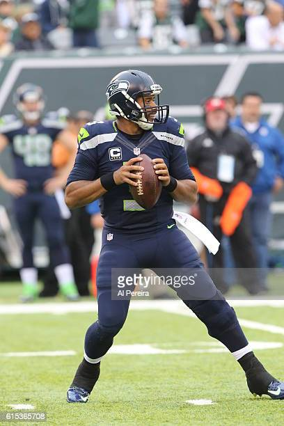 Quarterback Russell Wilson of the Seattle Seahawks passes the ball against the New York Jets during their game at MetLife Stadium on October 2 2016...