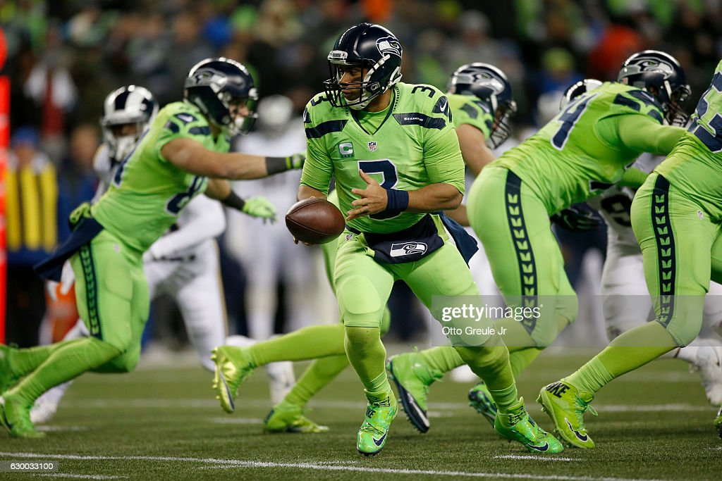 Quarterback Russell Wilson #3 of the Seattle Seahawks prepares to handoff the ball against the Los Angeles Rams at CenturyLink Field on December 15, 2016 in Seattle, Washington.