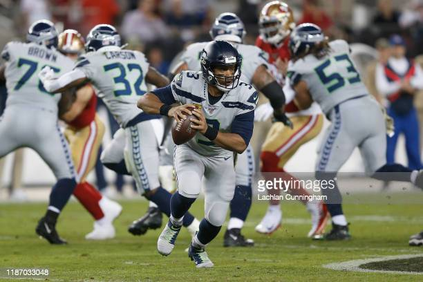 Quarterback Russell Wilson of the Seattle Seahawks runs the ball in the second quarter against the San Francisco 49ers at Levi's Stadium on November...