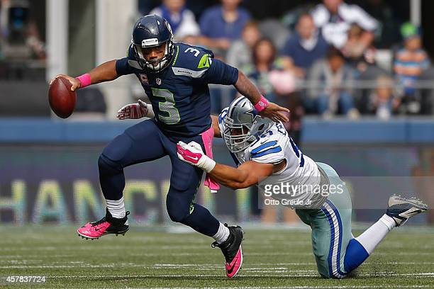Quarterback Russell Wilson of the Seattle Seahawks rushes against defensive end Tyrone Crawford of the Dallas Cowboys at CenturyLink Field on October...