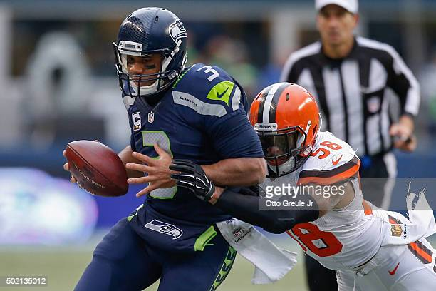 Quarterback Russell Wilson of the Seattle Seahawks rushes against linebacker Christian Kirksey of the Cleveland Browns at CenturyLink Field on...