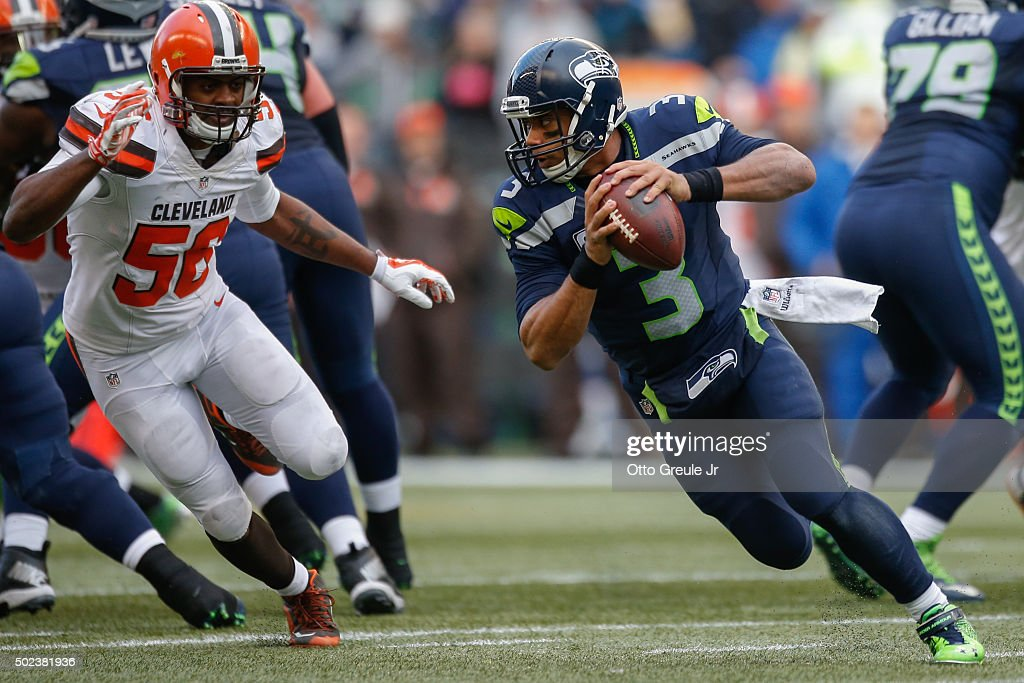 Quarterback Russell Wilson #3 of the Seattle Seahawks rushes against linebacker Karlos Dansby #56 of the Cleveland Browns at CenturyLink Field on December 20, 2015 in Seattle, Washington.