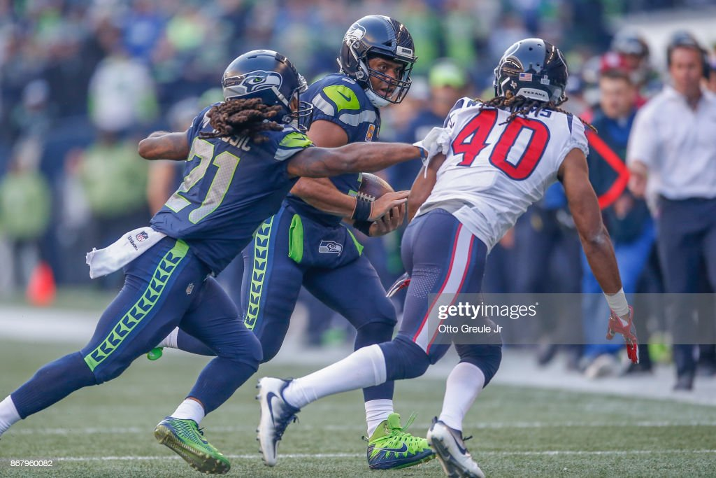 Quarterback Russell Wilson #3 of the Seattle Seahawks rushes against cornerback Marcus Williams #40 of the Houston Texans in the fourth quarter at CenturyLink Field on October 29, 2017 in Seattle, Washington.
