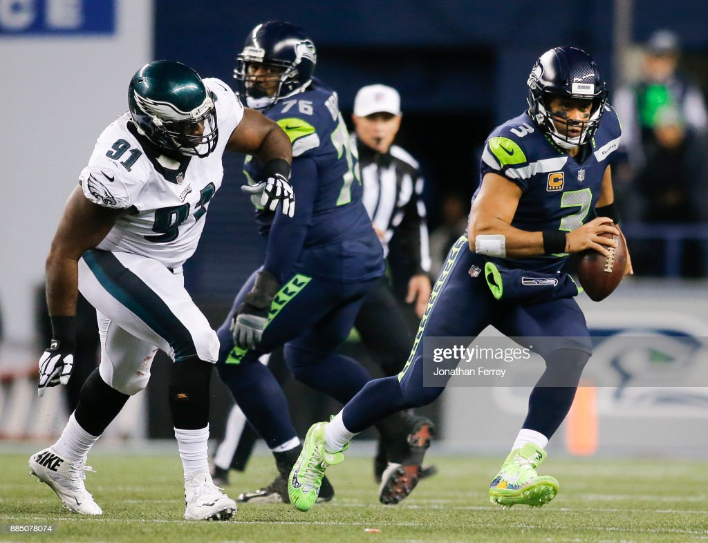 Quarterback Russell Wilson #3 of the Seattle Seahawks rushes against the Philadelphia Eagles in the fourth quarter at CenturyLink Field on December 3, 2017 in Seattle, Washington.