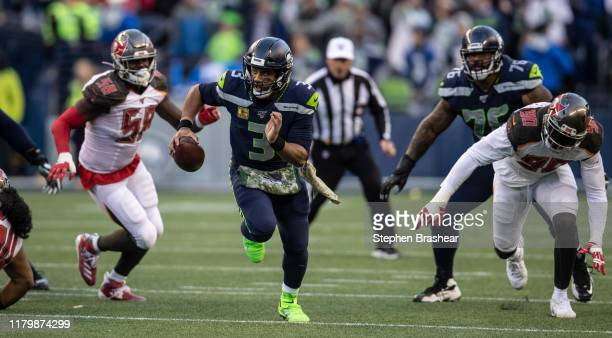 Quarterback Russell Wilson of the Seattle Seahawks rushes the ball during the second half of a game against the Tampa Bay Buccaneers at CenturyLink...