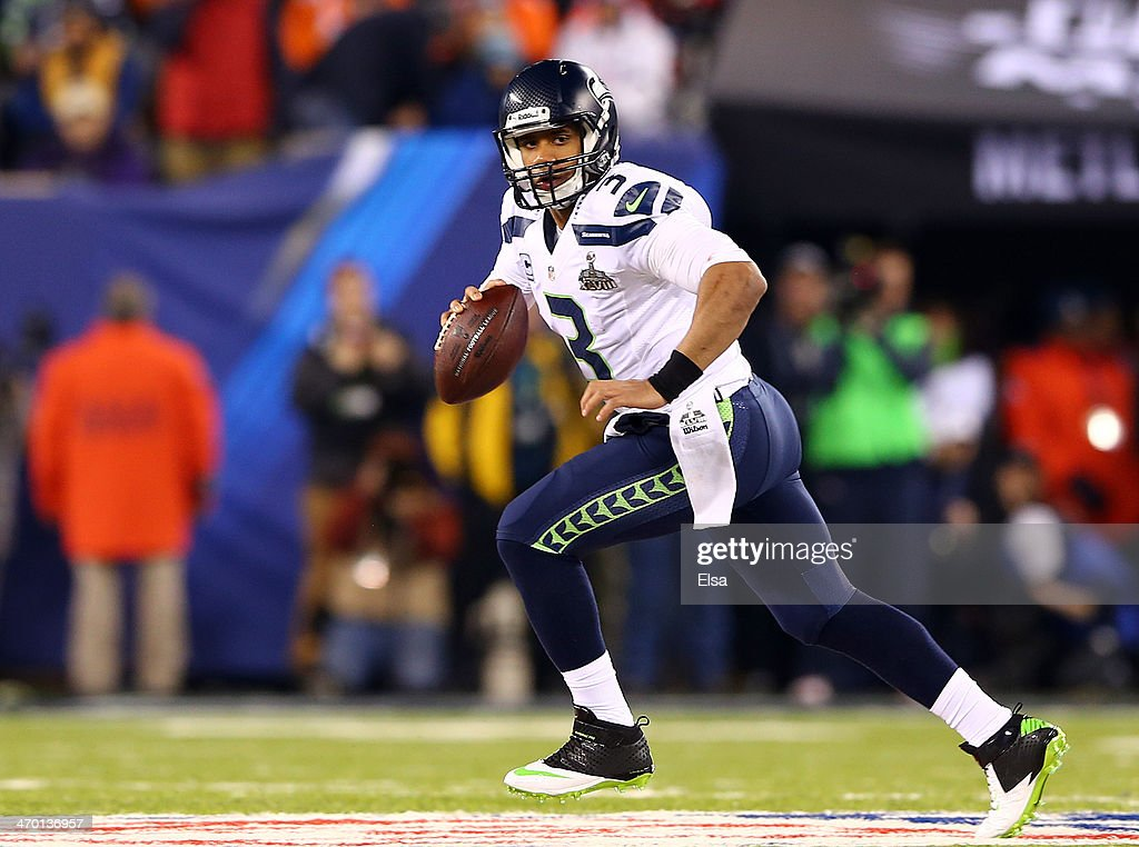 Quarterback Russell Wilson #3 of the Seattle Seahawks scrambles against the Denver Broncos during Super Bowl XLVIII at MetLife Stadium on February 2, 2014 in East Rutherford, New Jersey.