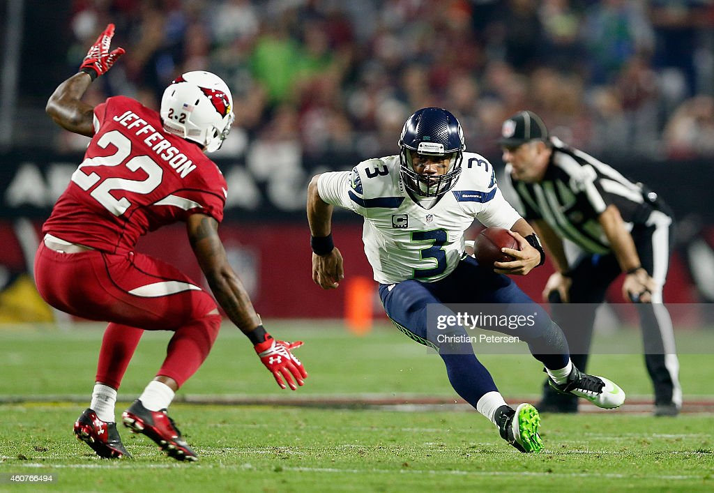 Quarterback Russell Wilson #3 of the Seattle Seahawks scrambles with the football against strong safety Tony Jefferson #22 of the Arizona Cardinals during the third quarter of the NFL game at the University of Phoenix Stadium on December 21, 2014 in Glendale, Arizona. The Seahawks defeated the Cardinals 35-6.