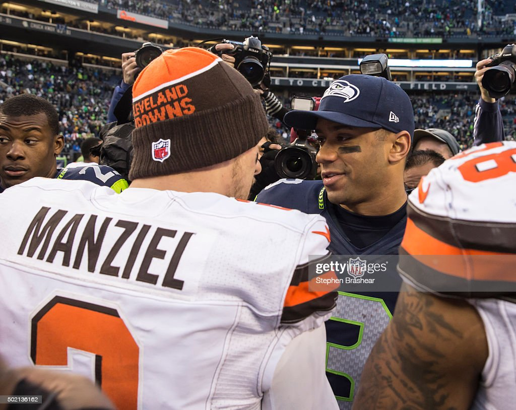 Quarterback Russell Wilson #3 of the Seattle Seahawks shakes hands with quarterback Johnny Manziel #2 after a football game at CenturyLink Field on December 20, 2015 in Seattle, Washington. The Seahawks won the game 30-13.
