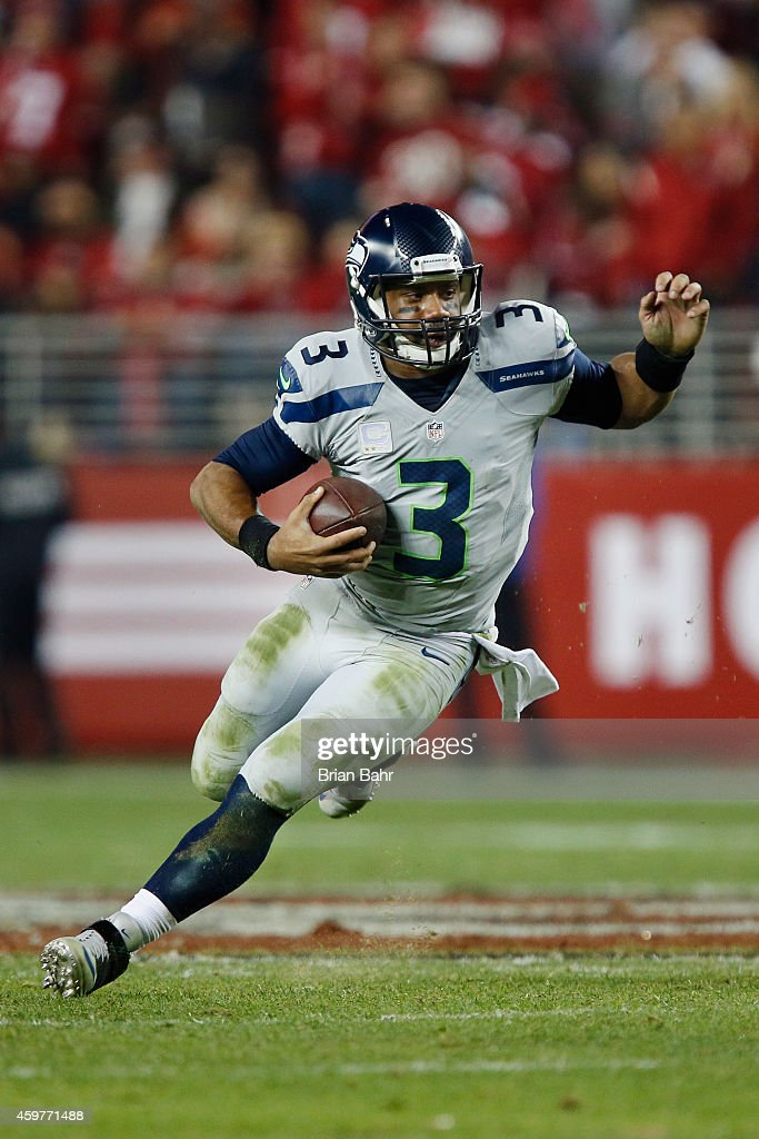 Quarterback Russell Wilson #3 of the Seattle Seahawks takes off running for a 12-yard gain against the San Francisco 49ers in the fourth quarter on November 27, 2014 at Levi's Stadium in Santa Clara, California. The Seahawks won 19-3.