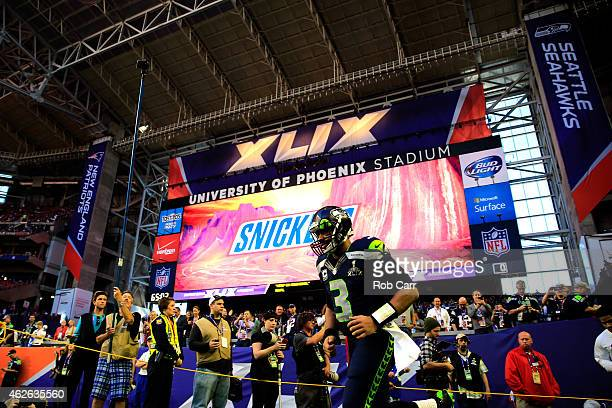 Quarterback Russell Wilson of the Seattle Seahawks takes the field prior to Super Bowl XLIX against the New England Patriots at University of Phoenix...