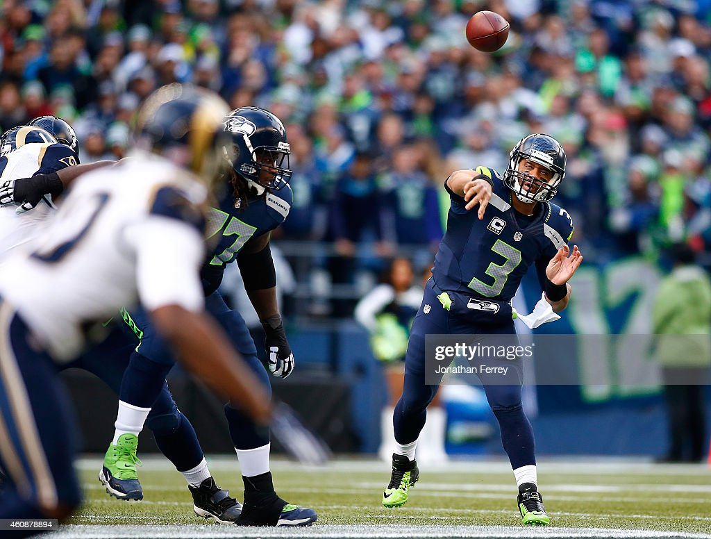 Quarterback Russell Wilson #3 of the Seattle Seahawks throws a pass against the St. Louis Rams at CenturyLink Field on December 28, 2014 in Seattle, Washington.