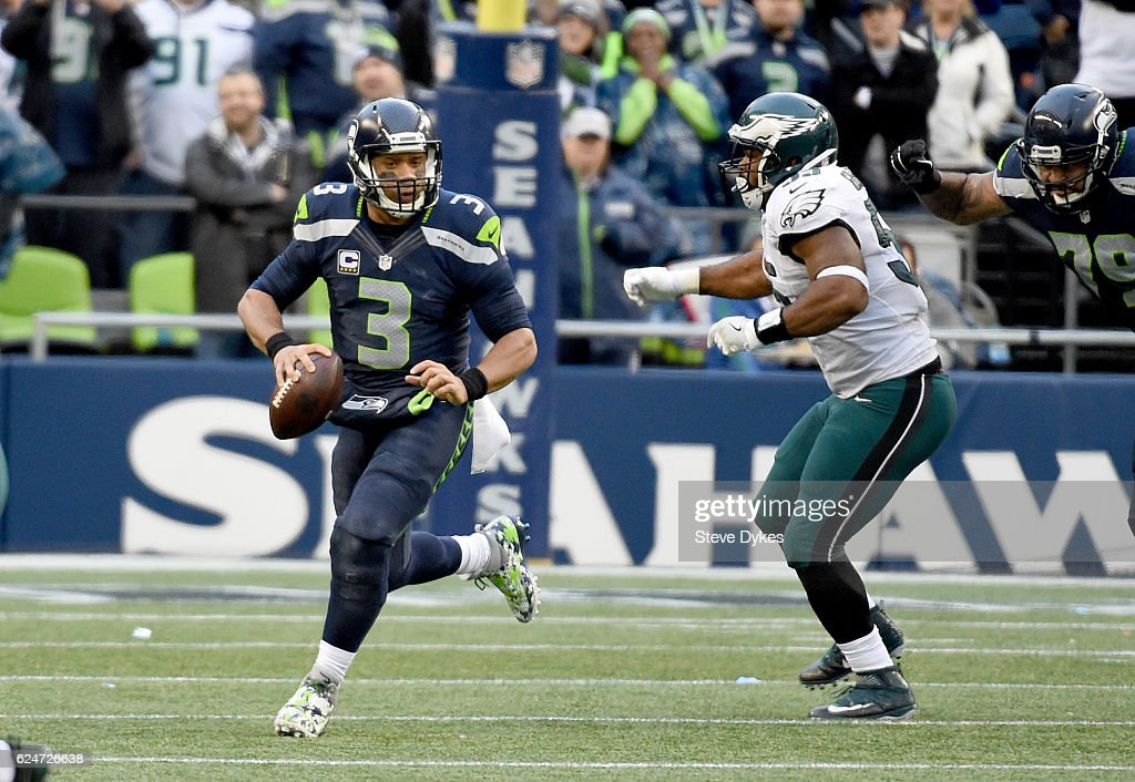 Quarterback Russell Wilson #3 of the Seattle Seahawks tries to evade defensive end Brandon Graham #55 of the Philadelphia Eagles at CenturyLink Field on November 20, 2016 in Seattle, Washington.