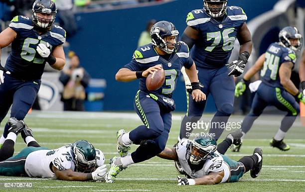 Quarterback Russell Wilson of the Seattle Seahawks tries to evade the Philadelphia Eagles defense at CenturyLink Field on November 20 2016 in Seattle...