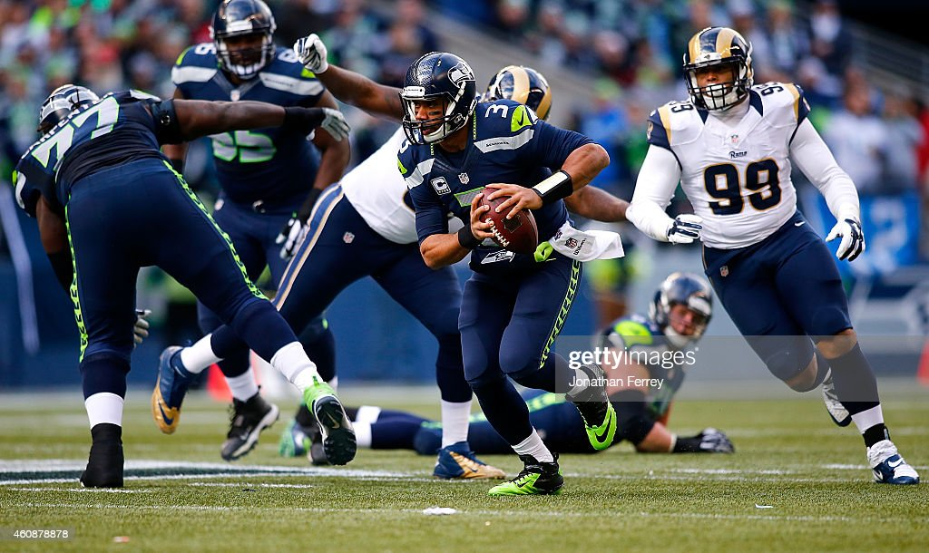 Quarterback Russell Wilson #3 of the Seattle Seahawks truns the ball against the St. Louis Rams at CenturyLink Field on December 28, 2014 in Seattle, Washington.