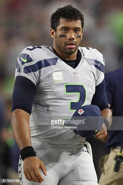 Quarterback Russell Wilson of the Seattle Seahawks walks along the sidelines in the first half during the NFL game against the Arizona Cardinals at...