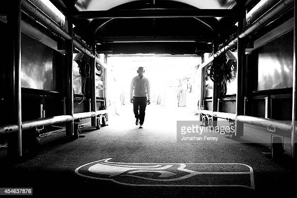 Quarterback Russell Wilson of the Seattle Seahawks walks into the tunnel before the game against the Green Bay Packers at CenturyLink Field on...