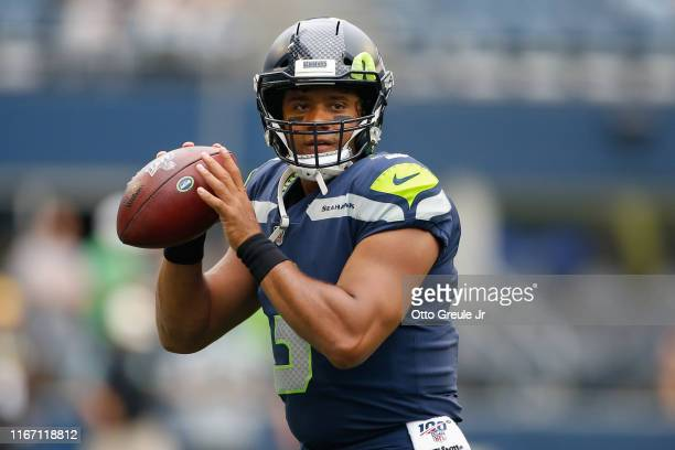 Quarterback Russell Wilson of the Seattle Seahawks warms up prior to the game against the Denver Broncos at CenturyLink Field on August 8 2019 in...