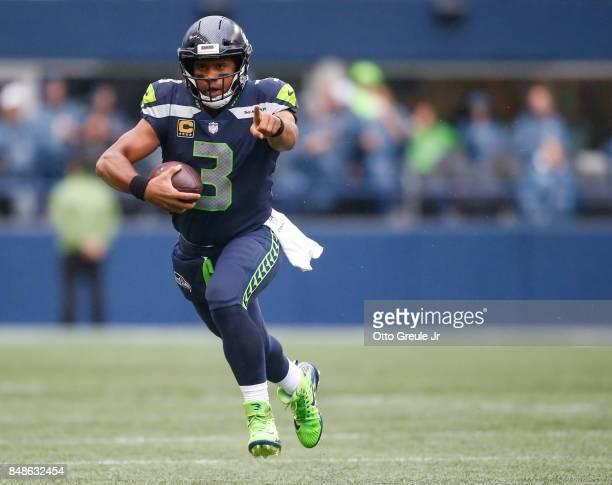 Quarterback Russell Wilson points as he takes off on a run against San Francisco 49ers during the the game at CenturyLink Field on September 17 2017...