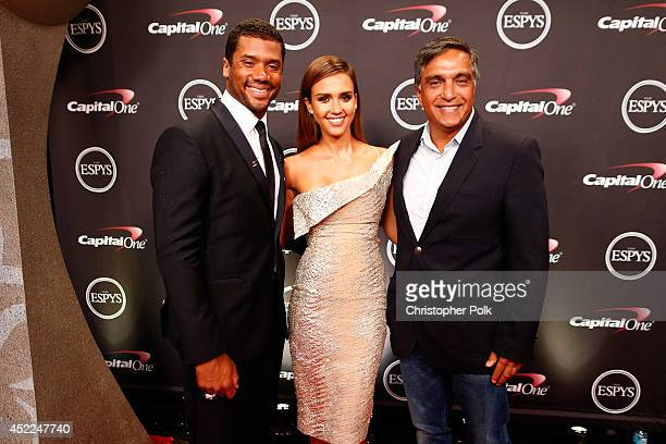 NFL quarterback Russell Wilson with actress Jessica Alba and her father Mark Alba attends The 2014 ESPYS at Nokia Theatre LA Live on July 16 2014 in...